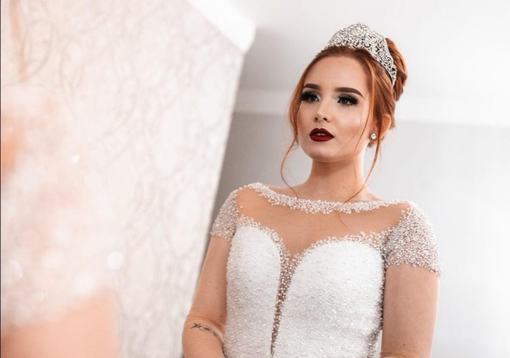 Bride posing in front of a mirror
